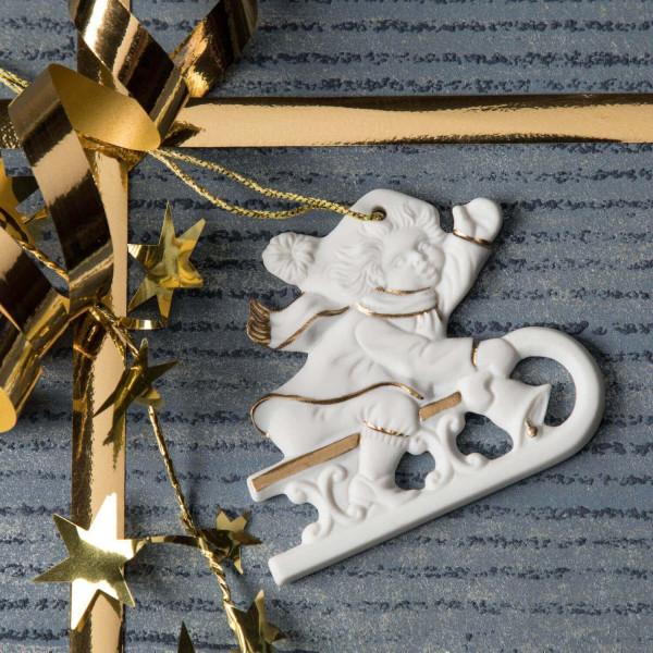 """Porzellan Weihnachtsanhänger """"Kind auf Schlitten"""""""