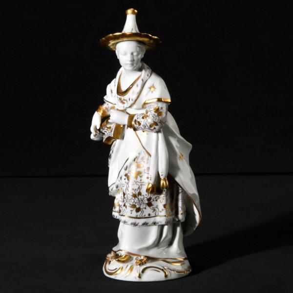 """Porzellanfigur """"Chinesin mit Drehlaute"""" aus glasiertem Porzellan. Malerei in Gold"""
