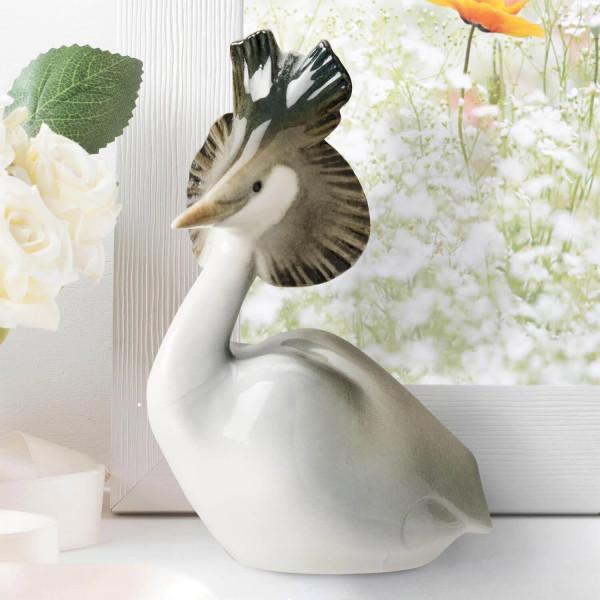 """Porzellanfigur """"Haubentaucher"""" aus glasiertem Porzellan, farbig dekoriert"""